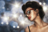 Fashion portrait of a beautiful brunette woman with shot hairstyle with orange sunglasses - studio photo — Stock Photo