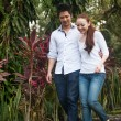 Asian couple walking on the park path — Stock Photo