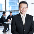Smiling asian business man portrait — Stock Photo
