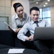 Business couple working with laptop — Stock Photo
