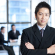 Confident asian businessman — Stock Photo