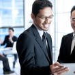 Business men using touchpad — Foto de stock #30839977