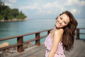 Attractive asian woman enjoing on the pier — Stock Photo