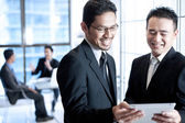 Business men using touchpad — Stock Photo