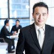 Smiling asian business man portrait — Foto de Stock
