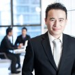 Smiling asian business man portrait — Stock Photo