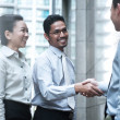 Smiling businessmen shaking hands — Stock Photo #30840045