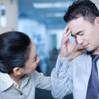 Asian business man with headache — Stock Photo