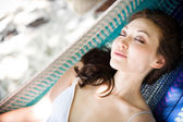 Attractive asian female relaxing on a hammock — Stock Photo