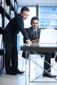 Business men using laptop for work — Stock Photo