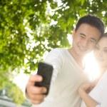 Asian Couple Taking Photographs — Stock Photo #8279109