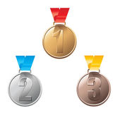 Medal awards for first, second and third place — Stock Vector