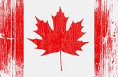 Bandera de Canadá en la madera — Vector de stock
