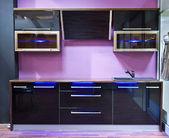 Modern purple kitchen interior with led light — Stock Photo