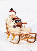 Boy on sledge — Stock Photo