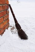 Homemade broom as cleaning equipment on snow winter — Stock Photo