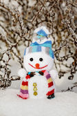 Snowman in the snow as no name toy — Stock Photo