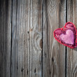 Red and pink heart on wooden background — Stock Photo