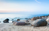 Sunset at rocky beach — Stock Photo