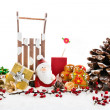 Close up of Santa sitting on wooden horse sledge holding gift an — Stok fotoğraf