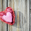 Red heart on wooden board — Stock Photo #38607175