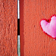 Red heart on wooden board — Stock Photo #38625993