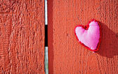 Red heart on wooden board — Stock Photo