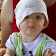 Funny lope-eared baby in a bonnet — Stock Photo