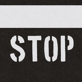 Seamless asphalt texture with stop sign — Stock Photo
