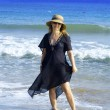 A woman walk around on the beach — Stock Photo