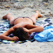 Stock Photo: Topless beautiful girl tanning