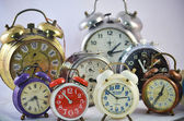 Ancient used alarm clocks — Stock Photo