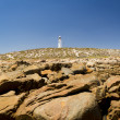 Stock Photo: Lighthouse and Rocks