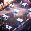 Stock Photo: Rooftop Tables
