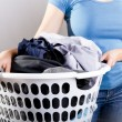 Woman Holding Dirty Laundry — Stock Photo