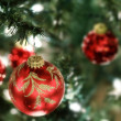 bright red ornaments on Christmas background — Stock Photo