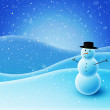 Snowman sitting on snowy hills — Stock Photo