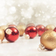 Bright red and gold ornaments — Stock Photo