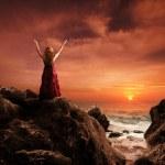Woman on mountain in praise and worship. — Stock Photo
