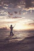 Woman praising in the ocean — Stock Photo