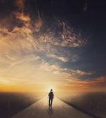 Man walking down road — Stock Photo
