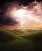 Cross struck by a lightning bolt during a dramatic and threatening electrical storm — Stock Photo