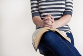 Woman holding a Bible on the knee — Stock Photo