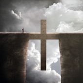 Two tall cliffs with big cross in between — Stock Photo