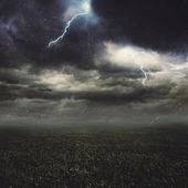 Lightning flash over a field — Stock Photo