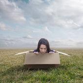 Woman stuck in box — Stock Photo