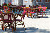 Cafe terrace with tables and chair — Stock Photo