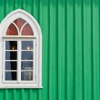 Green wall with window — Stock Photo #25684679
