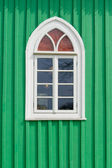 Green wall with window — Stock Photo