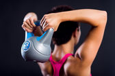 Fitness woman doing a weight training — Stock Photo